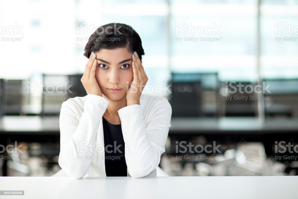 Stressed Asian Business Woman Touching Temples stock photo
