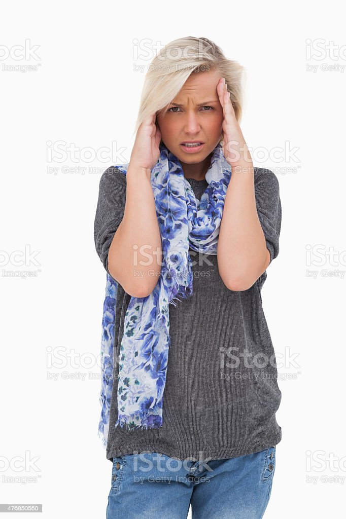 Stressed blonde looking at camera stock photo
