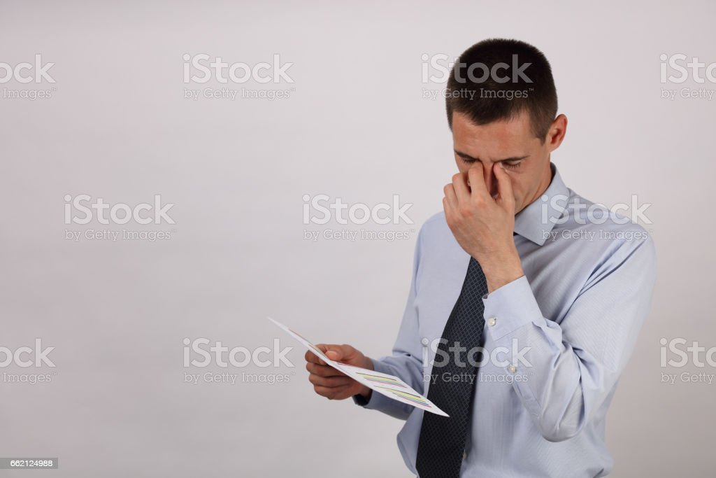 Stressed business man suffering from a headache isolated on white background royalty-free stock photo