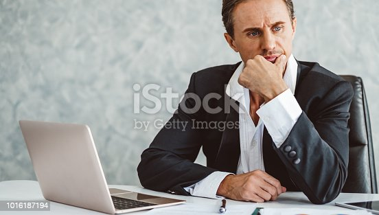 932342408istockphoto Stressed business man working in office 1016187194