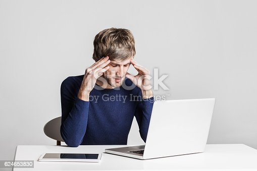 833210686 istock photo Stressed business man working on a laptop 624653830