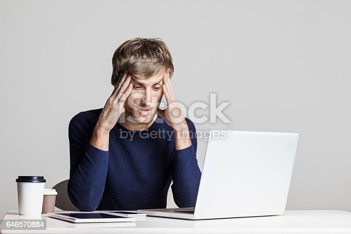 833210686 istock photo Stressed business man working on a laptop 646570884