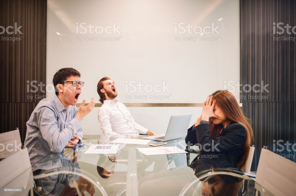 Stressed business team in meeting room, multi-ethnic stock photo