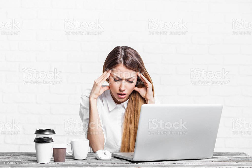 Stressed business woman working on a laptop stock photo
