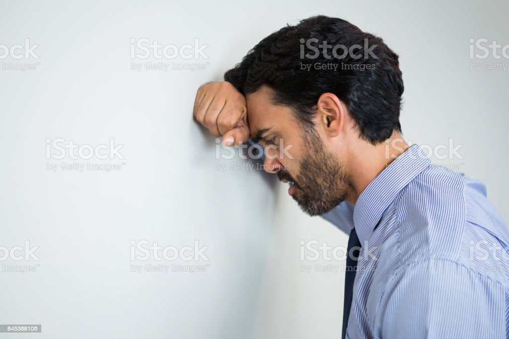 Stressed businessman at conference centre stock photo