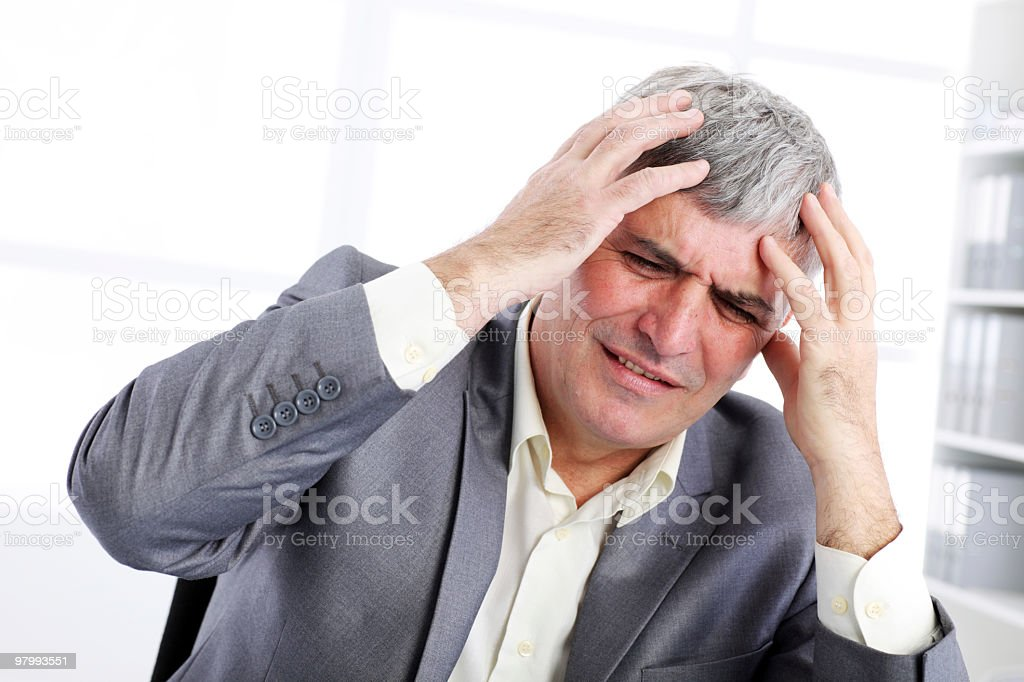 Stressed businessman at the office. royalty-free stock photo