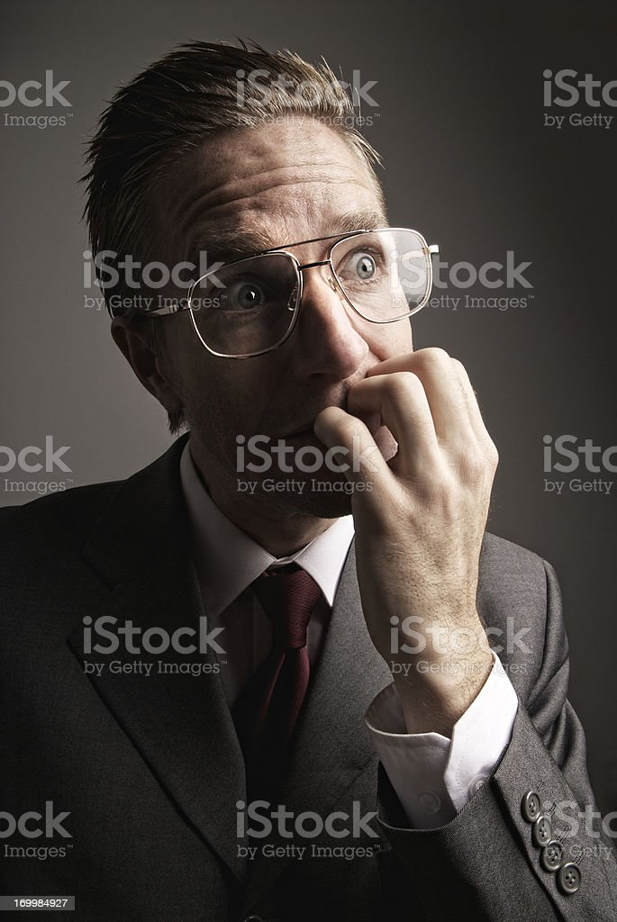 Stressed Businessman Biting Fingernails with Nervous Expression royalty-free stock photo