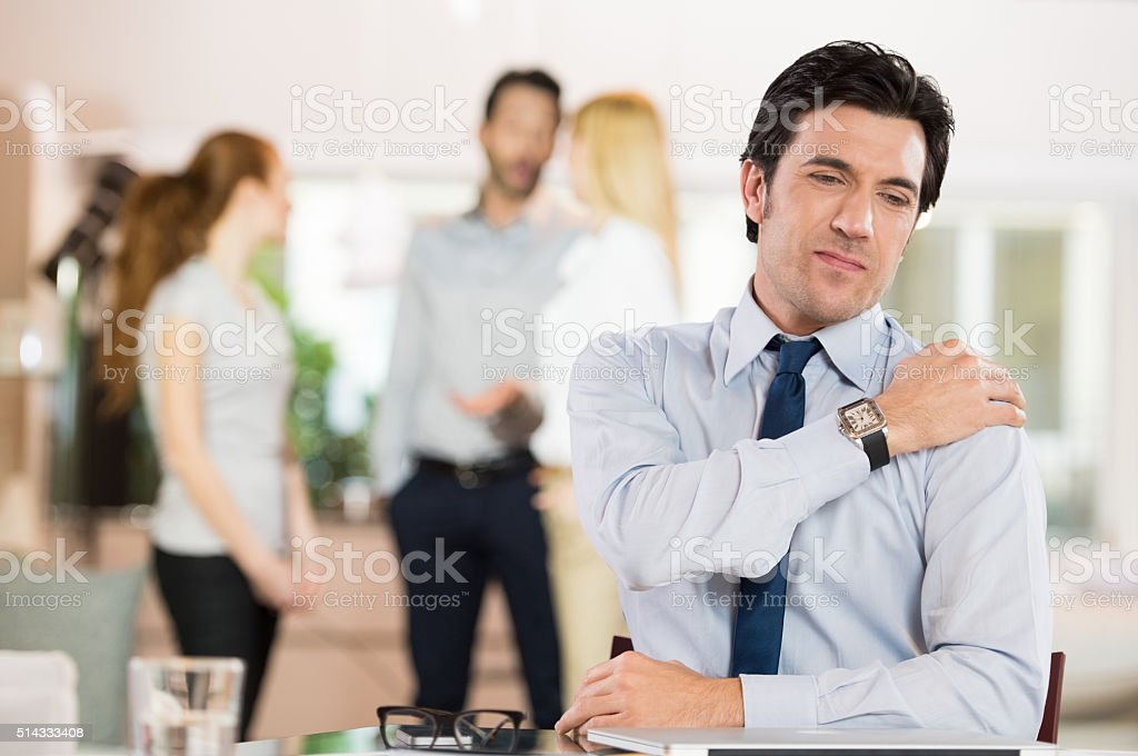 Stressed businessman having neck pain stock photo