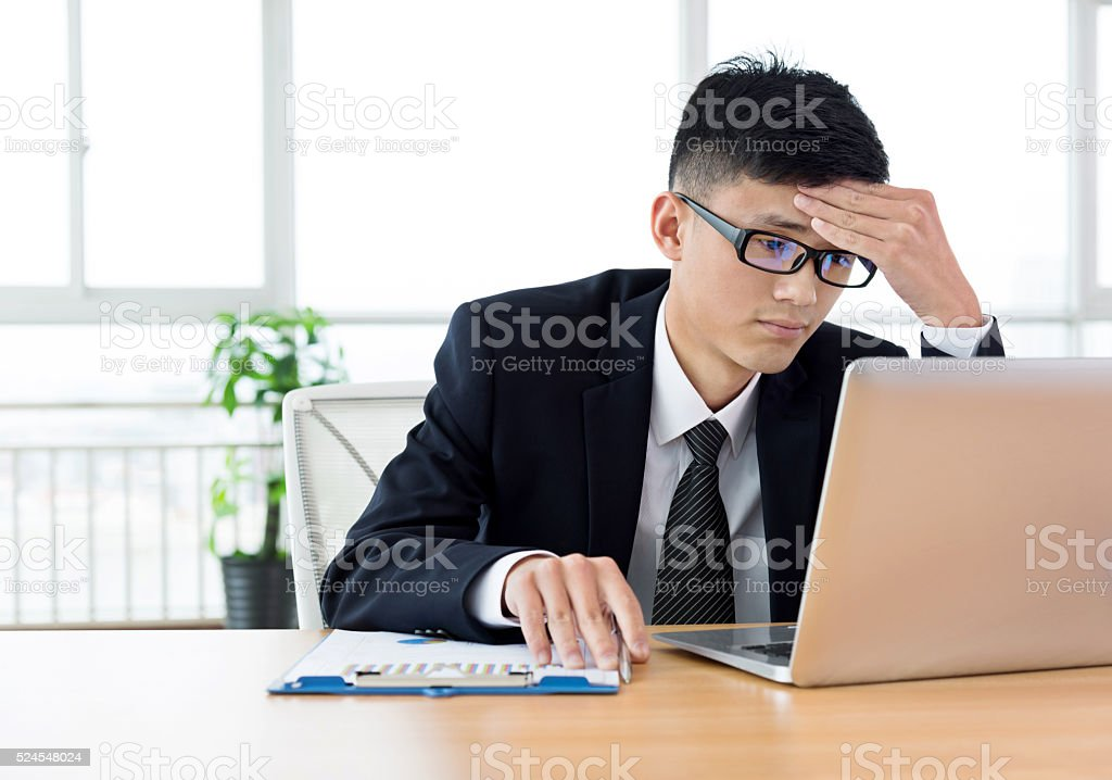 Stressed businessman in office stock photo