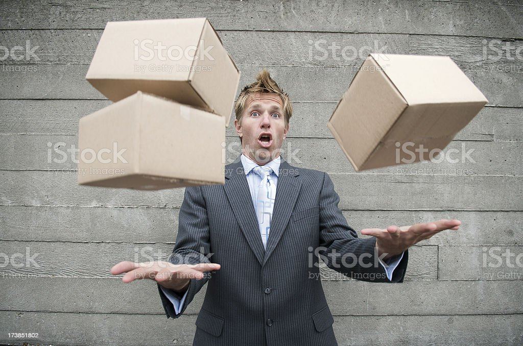 Stressed Businessman Juggling Boxes Outdoors royalty-free stock photo