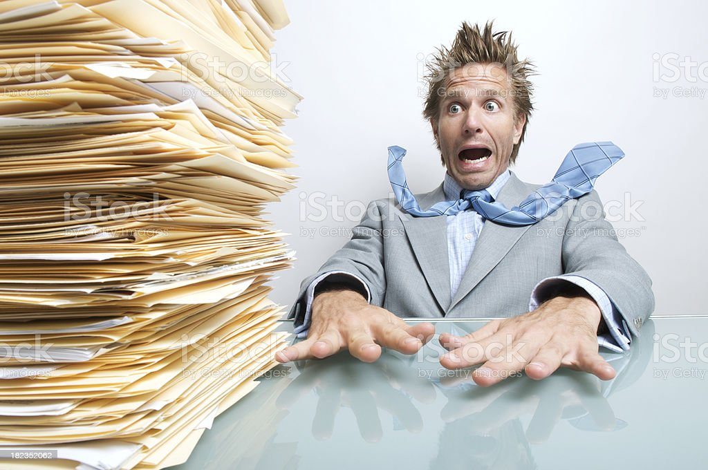 Stressed Businessman Office Worker Gasping at Huge Stack of Paperwork royalty-free stock photo