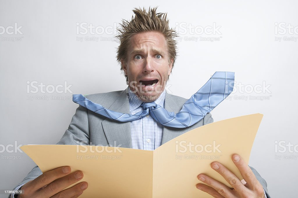 Stressed Businessman Office Worker Opening Manila Folder of Dread royalty-free stock photo