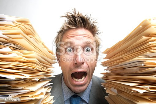 481644192 istock photo Stressed Businessman Office Worker Screaming for Help Between File Folders 182772575