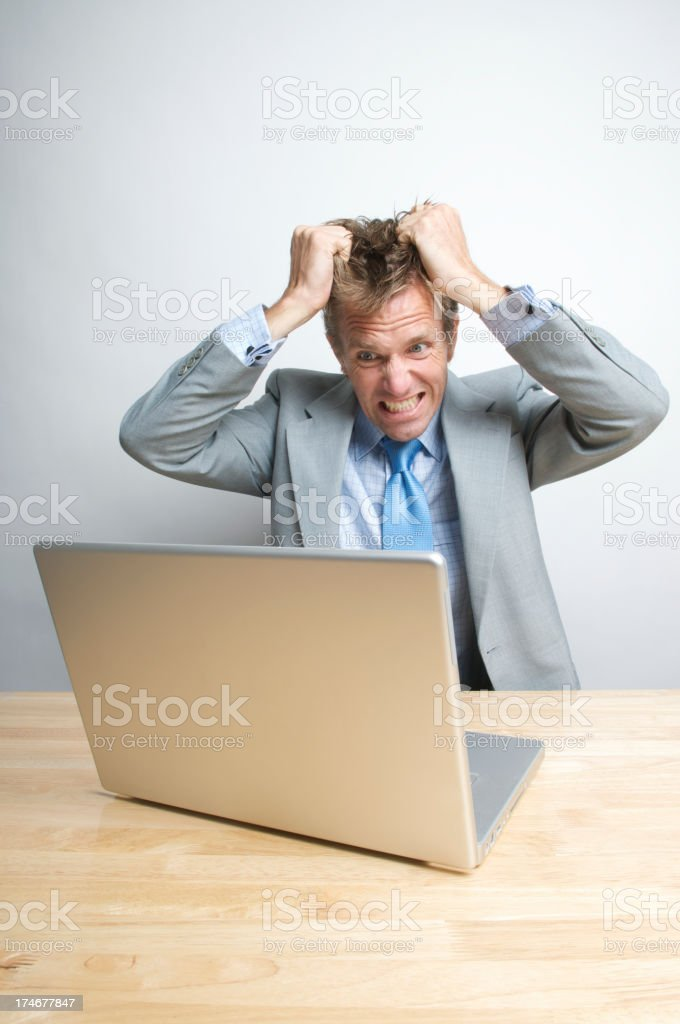 Stressed Businessman Office Worker Tearing His Hair Out at Desk royalty-free stock photo