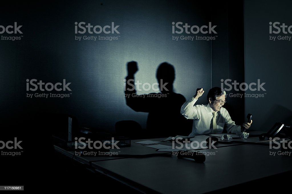 stressed businessman screaming at phone royalty-free stock photo