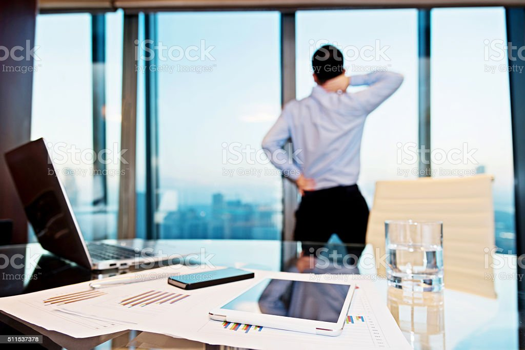 Stressed businessman stretching stock photo