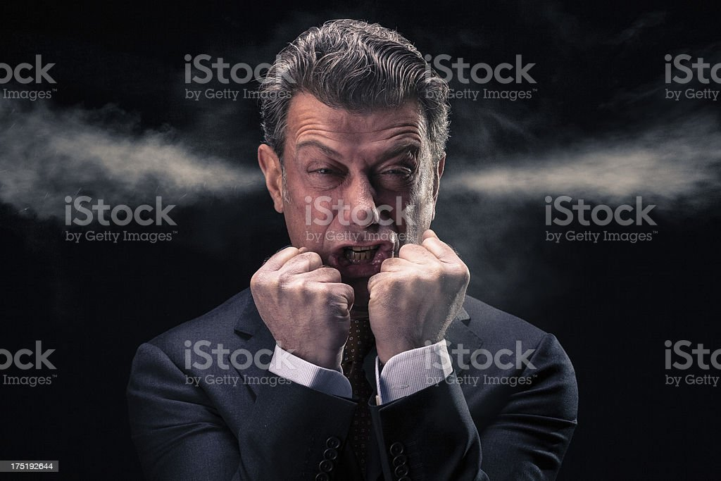 """Stressed Businessman with Steam Jets Blowing out of his Ears """"A stressed and upset businessman is really close to the edgeTwo steam jets go out from his ears.Ideal concept for: stress, discomfort, failure, angriness, mobbing, being close to the edge"""" Adult Stock Photo"""