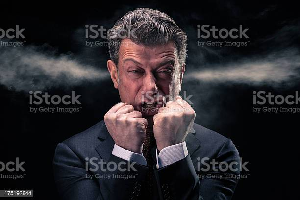 Stressed Businessman With Steam Jets Blowing Out Of His Ears Stock Photo - Download Image Now