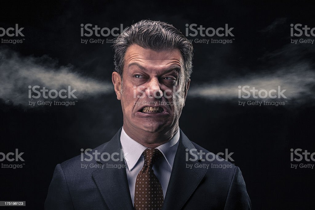 A stressed and upset businessman looking away is really close to the...