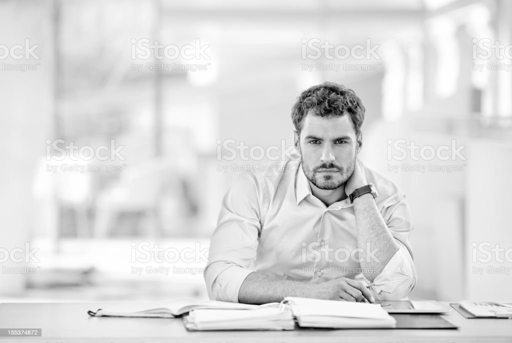 Stressed businessman working in office royalty-free stock photo