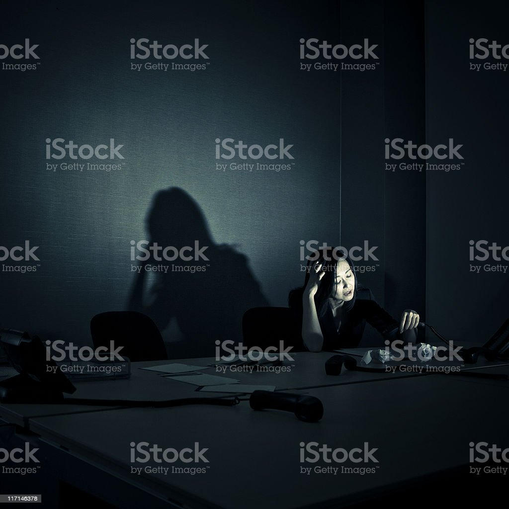 stressed businesswoman alone in her office royalty-free stock photo