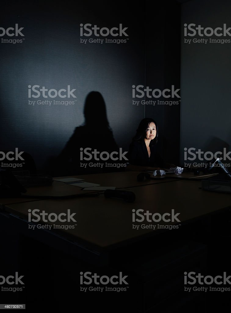 stressed businesswoman alone in her office stock photo