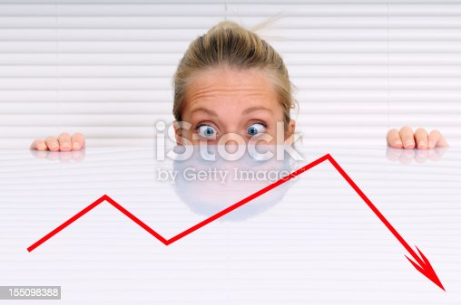 istock Stressed Businesswoman Analysing Moving Down Graph 155098388