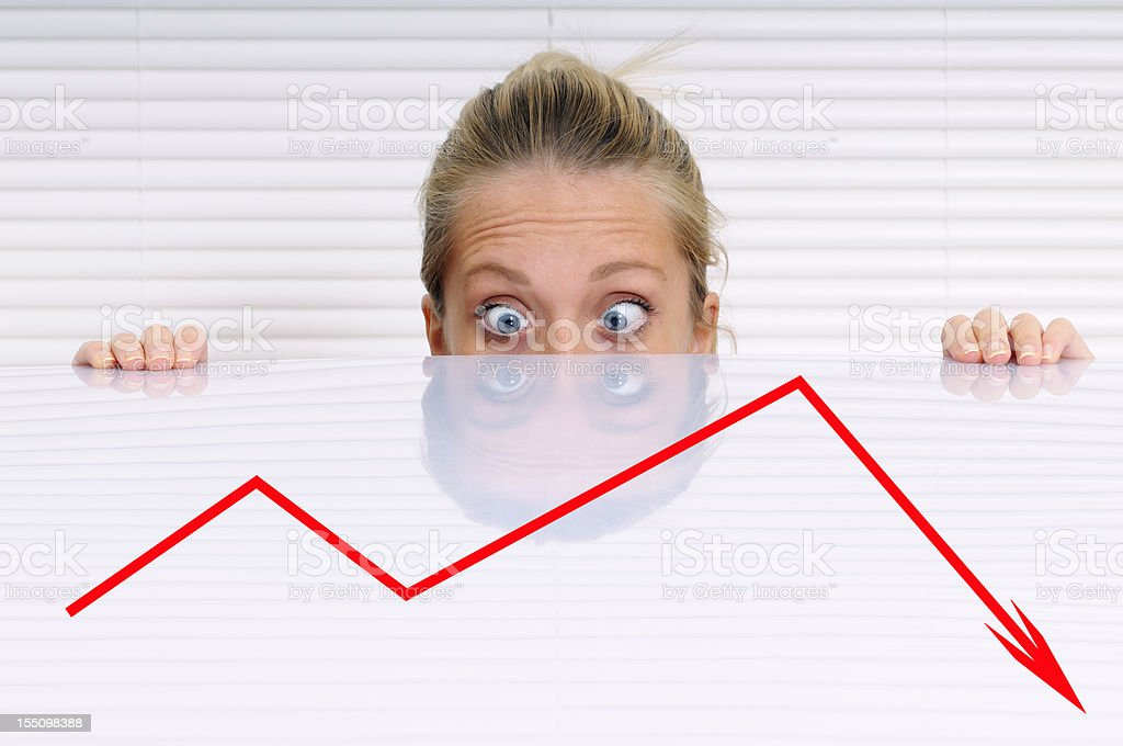 Stressed Businesswoman Analysing Moving Down Graph stock photo