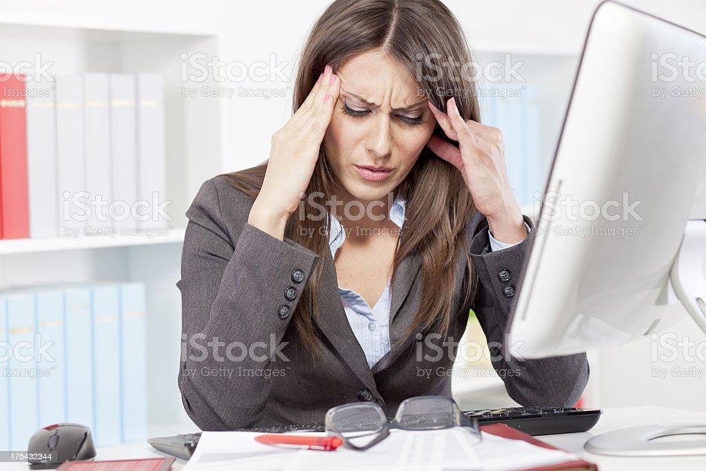 Stressed businesswoman having a headache royalty-free stock photo