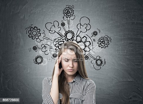 istock Stressed businesswoman, headache, cogs and gears 858726600