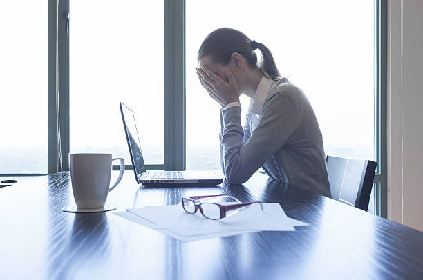 Stressed businesswoman Stressed businesswoman in the office. head in hands stock pictures, royalty-free photos & images