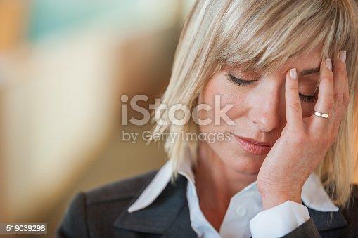 istock Stressed businesswoman 519039296