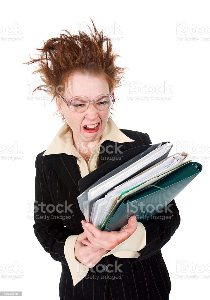 stressed  Businesswoman with huge stack of paperwork royalty-free stock photo