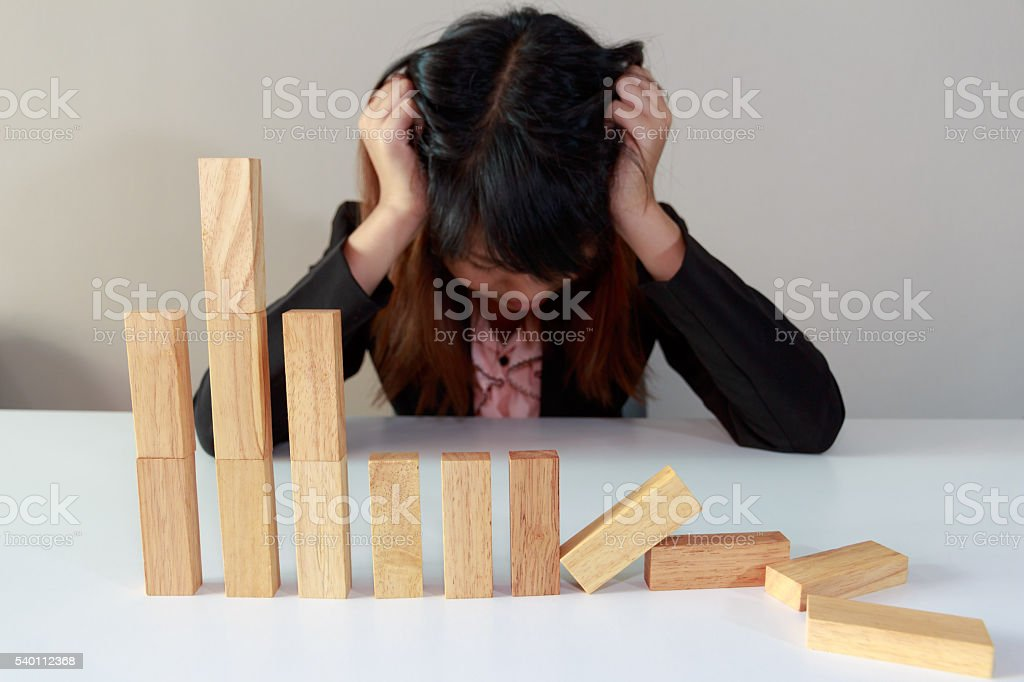 Stressed businesswoman with simulate stock market took a nosedive stock photo
