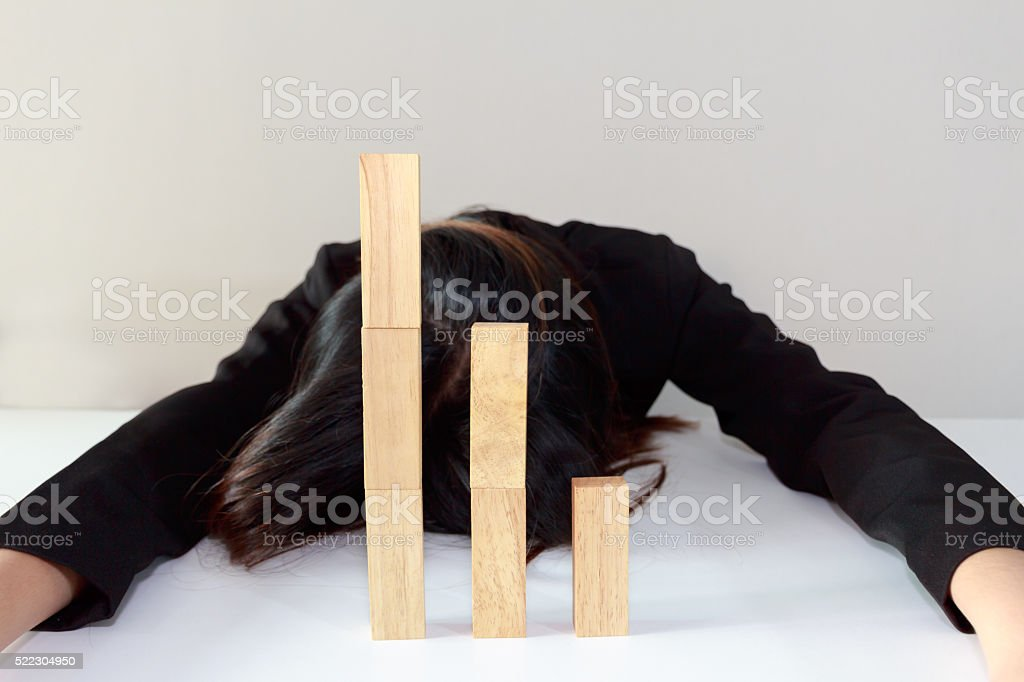 Stressed businesswoman with simulate stock market took nosedive stock photo