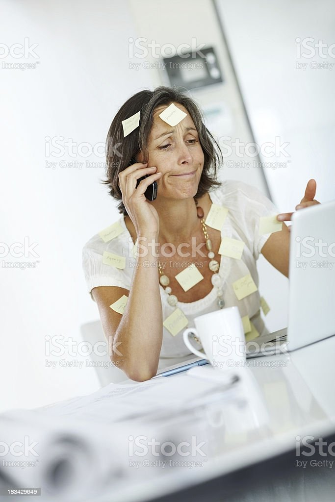 Stressed - Businesswoman with sticky notes on her body royalty-free stock photo