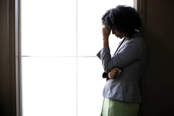 Stressed Businesswoman Worried by the Office Window stock photo