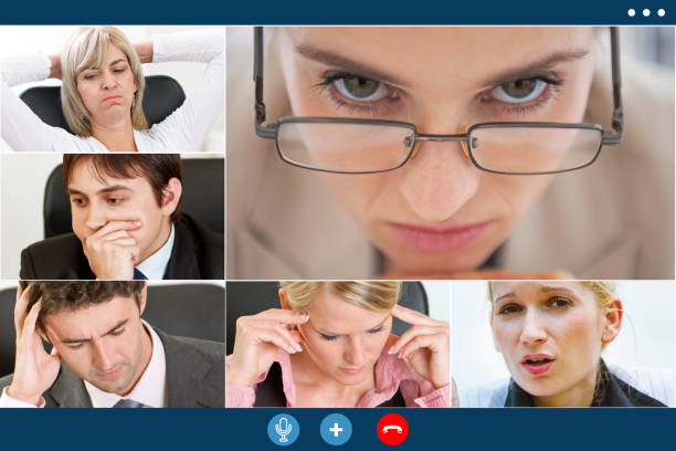 stressed colleagues having video meeting try to overcome crisis stock photo