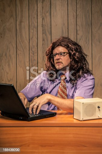 618210072 istock photo Stressed Computer IT Guy Working and Sweating at his Desk 155439200