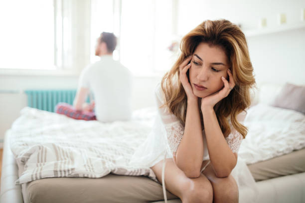 Stressed couple arguing and having marriage problems Frustrated couple arguing and having marriage problems background of the sad couple fighting bed stock pictures, royalty-free photos & images