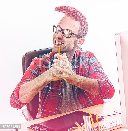 istock stressed entrepreneur with punk hair expressing breakdown with punching hands 627021364