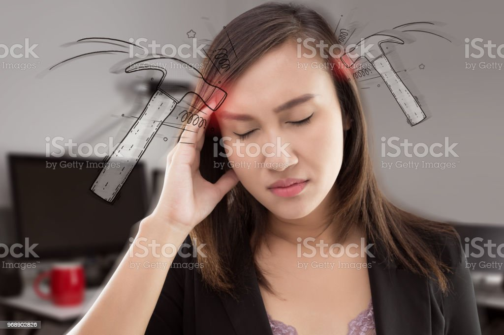Stressed exhausted asian woman having strong tension headache at office. stock photo