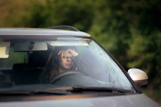 stressed female driver on a summer vacation road trip - impaired driving stock photos and pictures