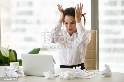 692461598 istock photo Stressed female worker panicking unable to finish work till deadline 1032228784