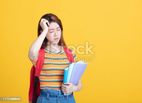 istock stressed  female young student holding books 1172488845