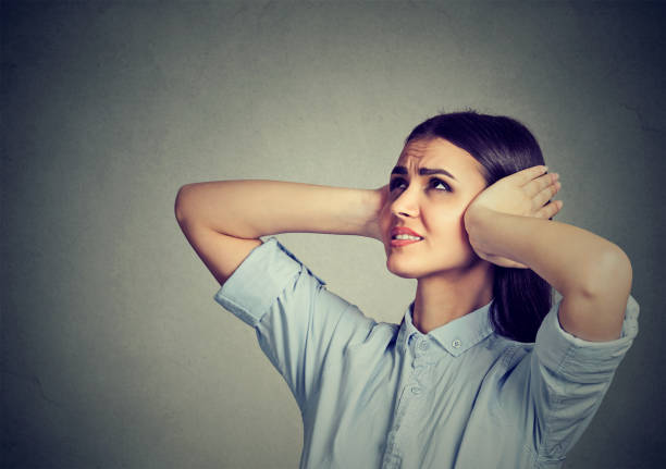 Stressed frustrated woman covering her ears with hands. Stressed frustrated woman covering her ears with hands. inconvenience stock pictures, royalty-free photos & images