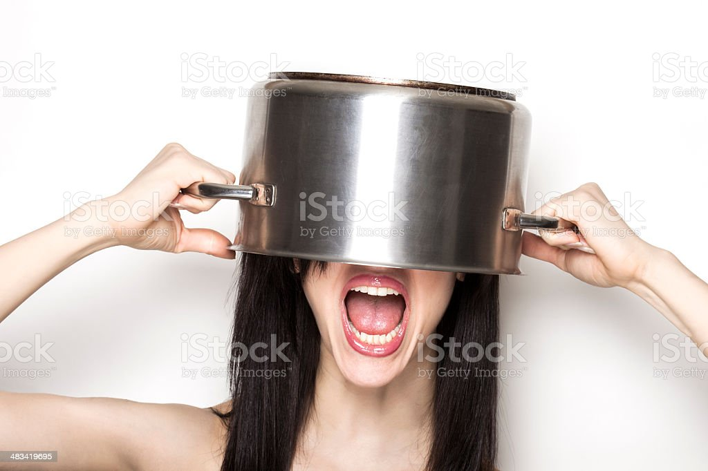 Stressed girl wearing a pot as hat stock photo