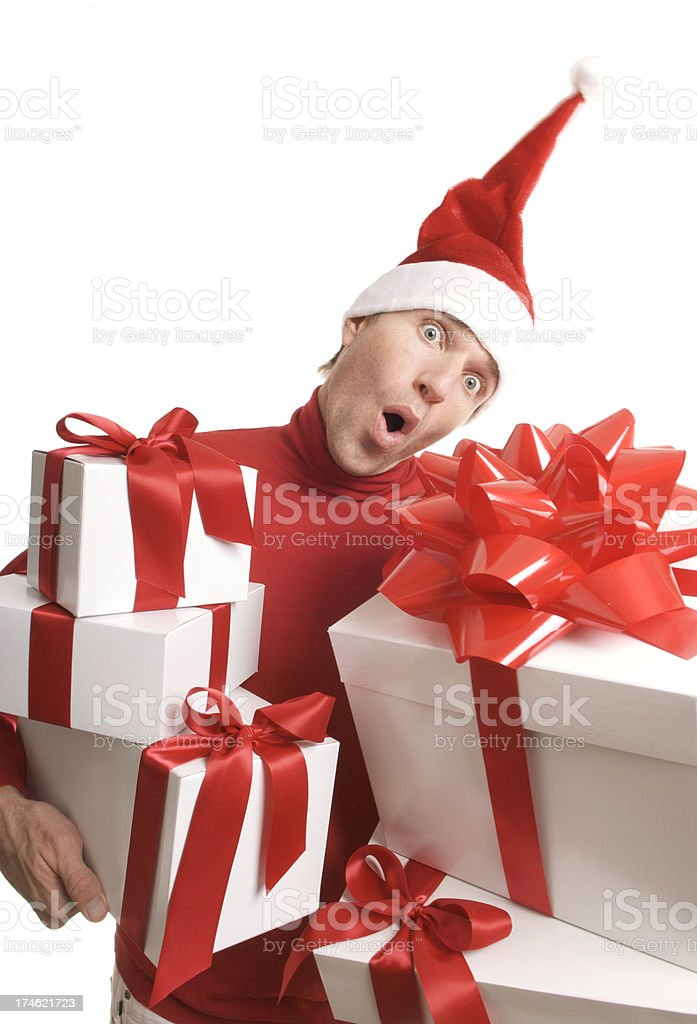 Stressed Holiday Elf Carries Gifts White Background royalty-free stock photo
