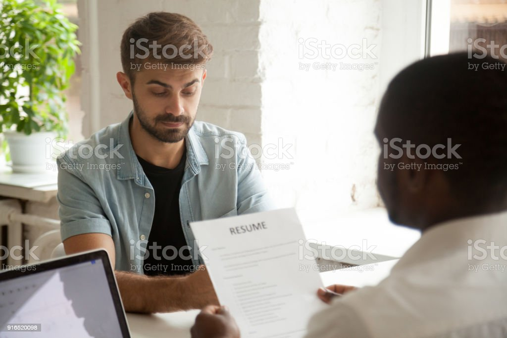 Stressed job applicant feeling nervous worried while hr reading resume stock photo