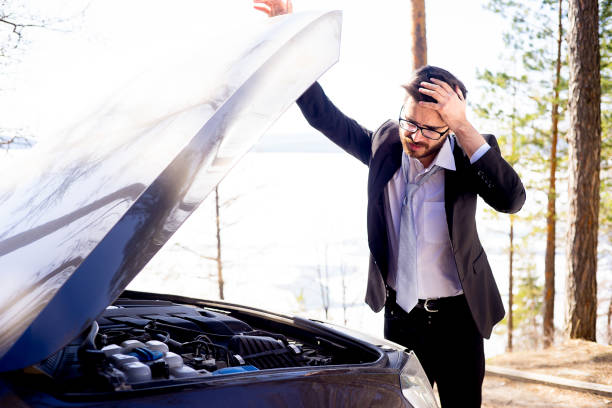 Stressed man had a car accident A stressed man had a car accident failure stock pictures, royalty-free photos & images